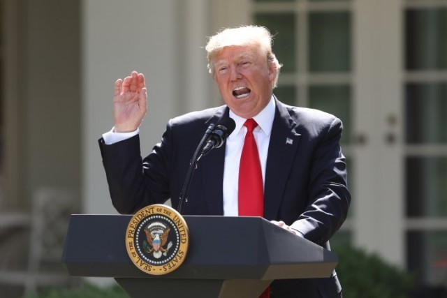 U.S. President Donald Trump speaks during an announcement in the Rose Garden of the White House in Washington, D.C., U.S., on Thursday, June 1, 2017. Trump announced the U.S. would withdraw from the Paris climate pact and that he will seek to renegotiate the international agreement in a way that treats American workers better. Photographer: Andrew Harrer/Bloomberg via Getty Images